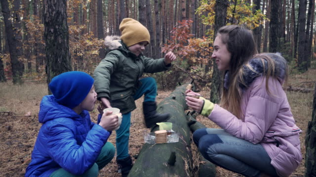 children having snack in the forest during walk - biscuit stock videos & royalty-free footage