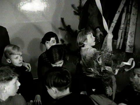 children help to put up christmas decorations - surrey england stock-videos und b-roll-filmmaterial
