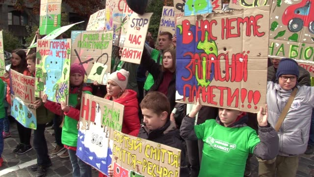 children hold posters and shout slogans during the 'global climate strike' climate change action protest in kiev, ukraine, on 20 september, 2019.... - strike protest action stock videos & royalty-free footage