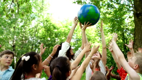 children hold the world in their hands - environmental conservation stock videos & royalty-free footage