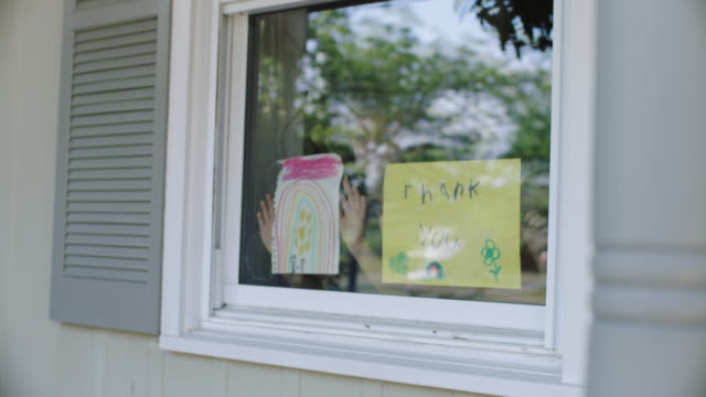children hold up thank you signs to window. - thank you phrase stock videos & royalty-free footage