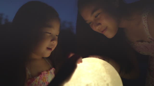 children holding the moon at night - astronomy telescope stock videos & royalty-free footage