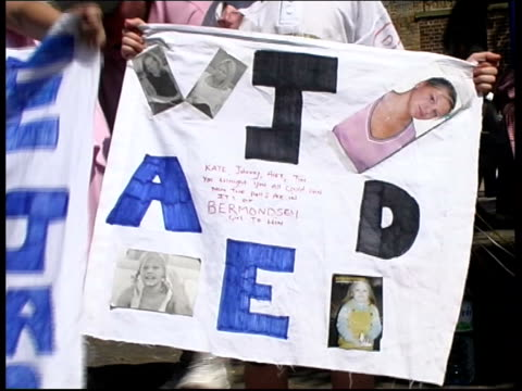 CRITICISM Children holding up banners supporting Jade Child wearing tshirt decorated with pictures of Jade
