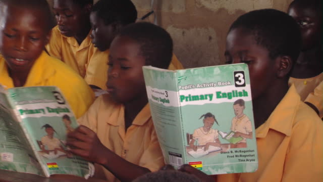 ms children holding workbooks sitting in classroom, tamale, ghana - elementary school stock videos and b-roll footage