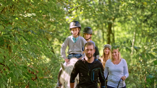 children horseback riding in the forest - recreational horseback riding stock videos & royalty-free footage