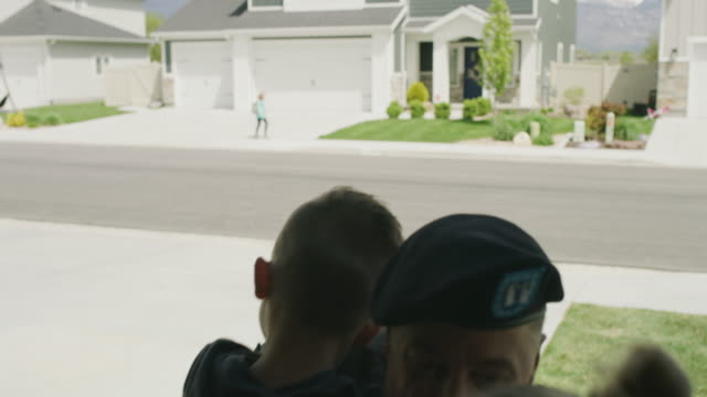 vídeos y material grabado en eventos de stock de children hugging and kissing soldier father returning home from duty / lehi, utah, united states - lehi