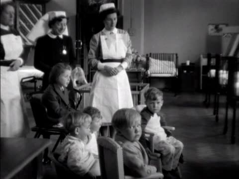children in a hospital ward in belfast watch the coronation celebrations on a television - coronation stock videos and b-roll footage