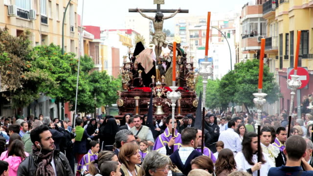 children in a religious procession with the nazarenos, semana santa, malaga, andalucia, spain, europe - holy week stock videos & royalty-free footage