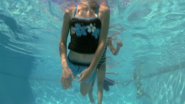 stockvideo's en b-roll-footage met children in a swimming pool - buitenbad