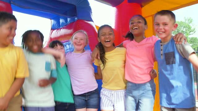children in bounce house, girl with down syndrome - 8 9 years stock videos & royalty-free footage