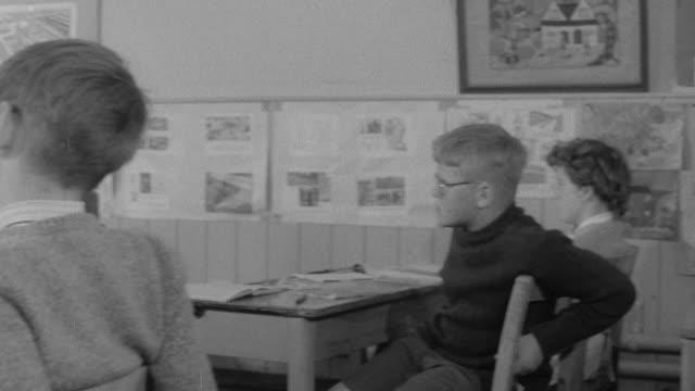 1960 MONTAGE Children in classroom listening to math teacher / United Kingdom