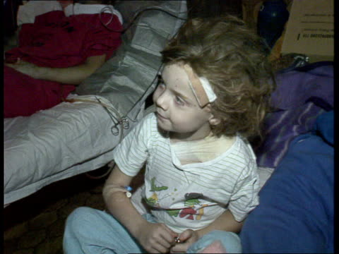 children in danger - sanya; int/1991 croatia vukovar tcms sanya wired to drip dr ruzica velinirovic intvw sot - there was no blood in the hospital...... - mensch und maschine stock-videos und b-roll-filmmaterial