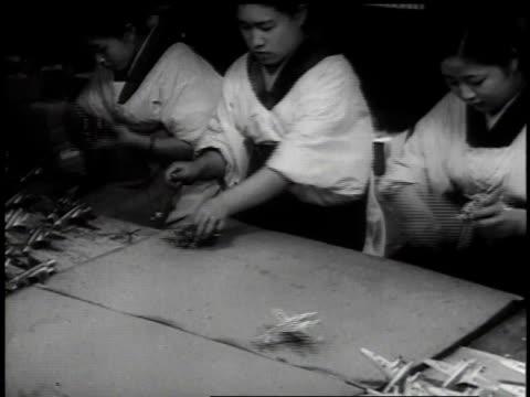 1939 ha children in kimonos operating toy planes / japan - 1930~1939年点の映像素材/bロール