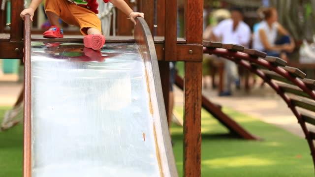 children in playground with slider - soft focus stock videos & royalty-free footage