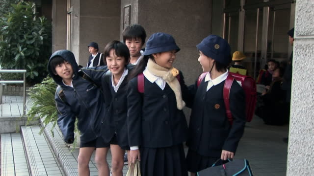 Children in school uniforms smiling at camera / Tokyo