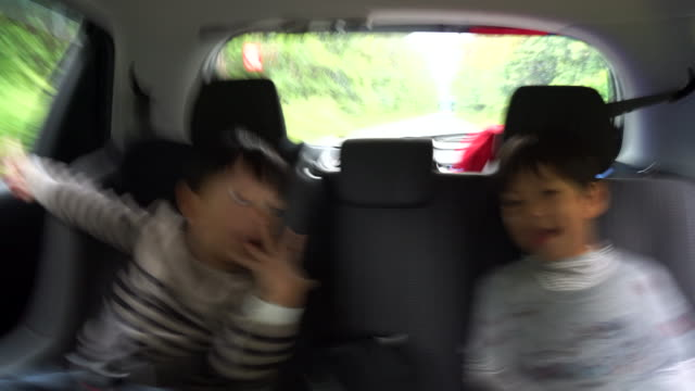 children in the back seat, having fun - land vehicle stock videos & royalty-free footage