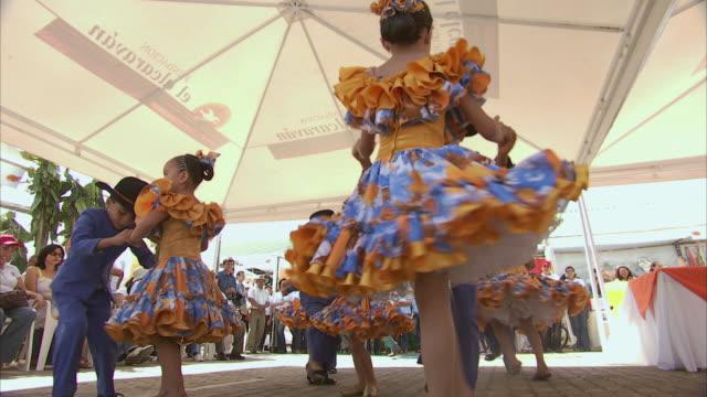 LA Children in traditional dress dancing an intricate dance at a fiesta / Bogota, Colombia