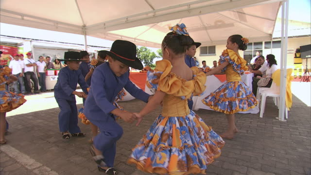 tu children in traditional dress dancing with intricate footwork at a fiesta / bogota, colombia - colombia stock videos & royalty-free footage
