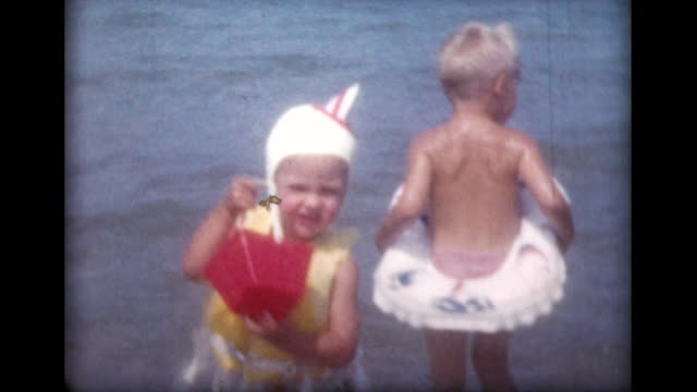 1959 children jumping and swimming with inflatable tubes - swimming cap stock videos & royalty-free footage