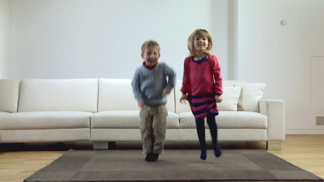 WS SLO MO Children (2-3) jumping up and down / London, UK