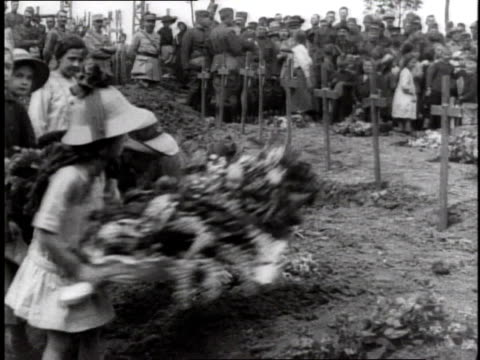 children laying flowers on fresh cross marked graves then turning away / germany - 1918 stock videos and b-roll footage