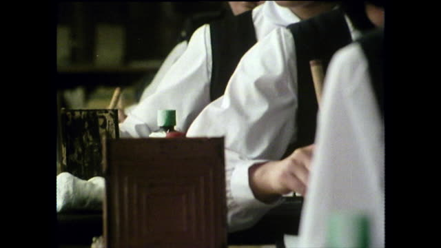 children learn japanese calligraphy in classroom; 1975 - japanese school uniform stock videos & royalty-free footage