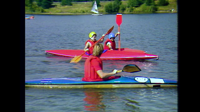 children learn to paddle kayaks at uk summer camp; 1984 - kayak stock videos & royalty-free footage