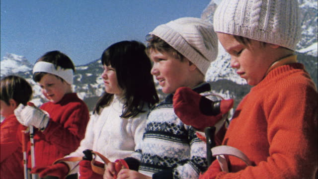 children learn to ski as parents watch. - winter sport stock videos & royalty-free footage