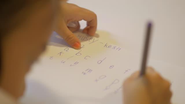 Children learn to write.