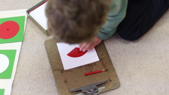 Children learning in Montessori school environment