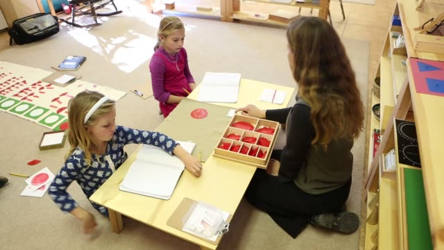 children learning in montessori school environment - hair accessory stock videos and b-roll footage