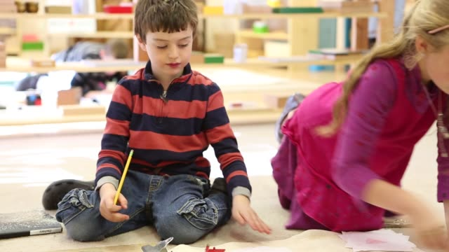 Children learning in Montessori school environment