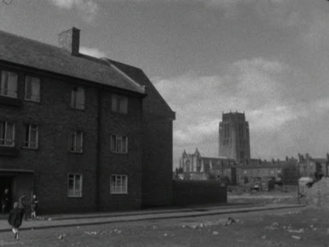 children leave a block of flats and run towards disused land in liverpool. 1964 - merseyside stock videos & royalty-free footage