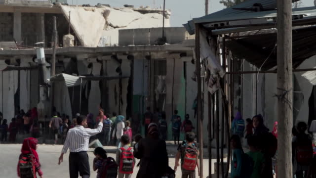 children leaving school in the wartorn town of sinjar syria - sinjar stock videos & royalty-free footage