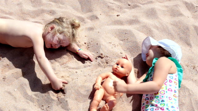 children lie on the sandy beach. sharm el sheikh. egypt. - swimwear stock videos & royalty-free footage