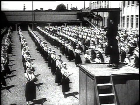 1939 montage children line up with sticks watching and copying instructor's moves on the platform, then instructor gives an order and the boys charge each other / japan - samurai stock videos & royalty-free footage