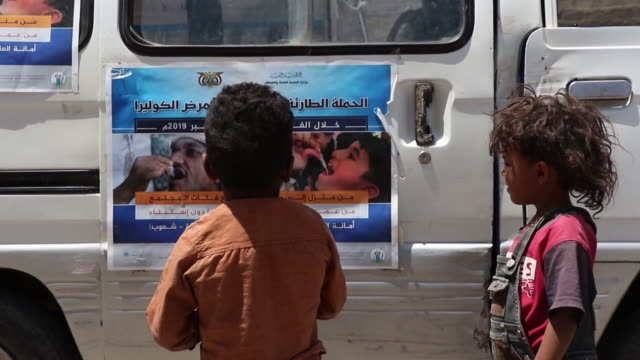children look at a poster during a vaccination campaign on september 19, 2019 in sana'a, yemen. yemen's local health authorities, with support from... - vibrio stock videos & royalty-free footage