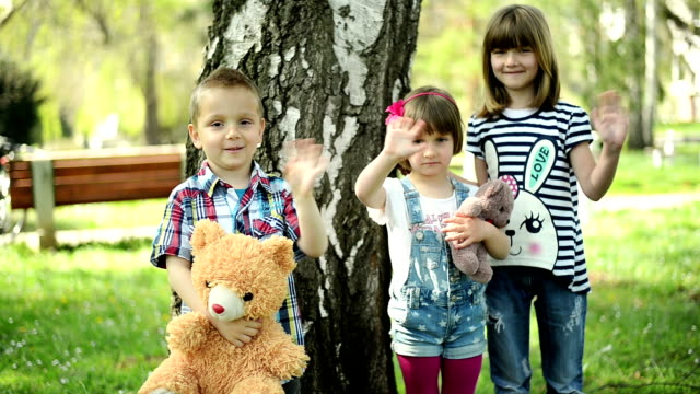 children looking at camera - teddy boy stock videos & royalty-free footage