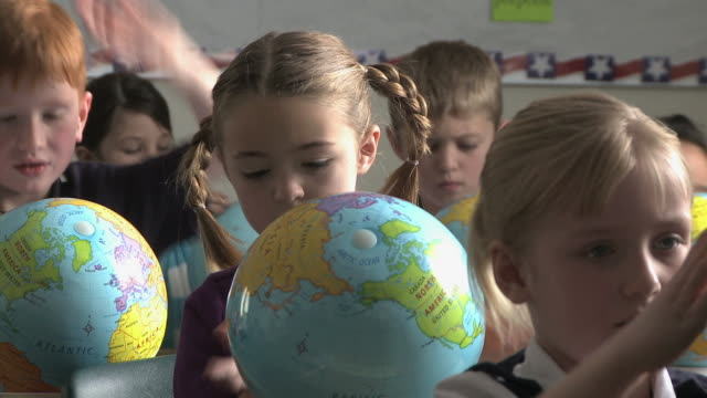 children looking at globes - see other clips from this shoot 1148 stock videos and b-roll footage