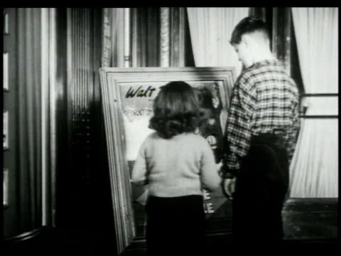 1948 montage children looking at movie poster / united states - poster stock videos & royalty-free footage