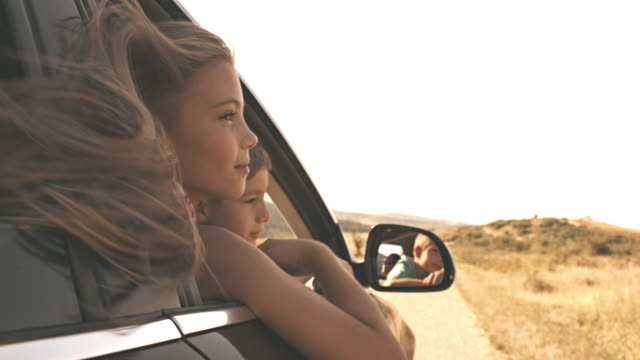 children looking out car window - automobile video stock e b–roll