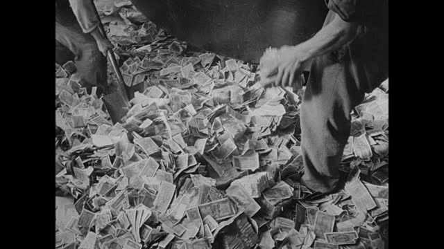 vídeos de stock, filmes e b-roll de children looking through rubble heap for food discarding paper money for sale bread. paper currency bills being scooped from floor destroyed in large... - 1946