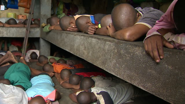 children lying face down in overcrowded antalaha prison imprisoned for vanilla theft crimes in sava region madagascar - face down stock videos & royalty-free footage