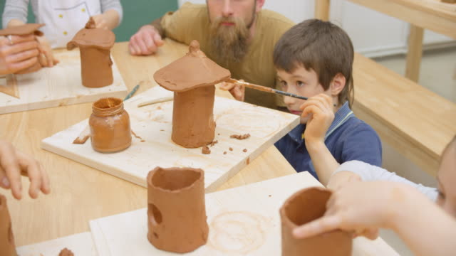 children making ceramic bird houses in the classroom - birdhouse stock videos & royalty-free footage