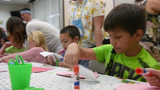 children making crafts, dancing and playing games at the vacation bible school, mcas iwakuni base chapel. - art and craft stock videos & royalty-free footage