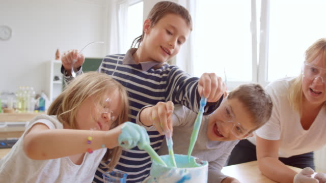 children mixing color into a mixture of water and soap in a large pitcher - pitcher jug stock videos & royalty-free footage