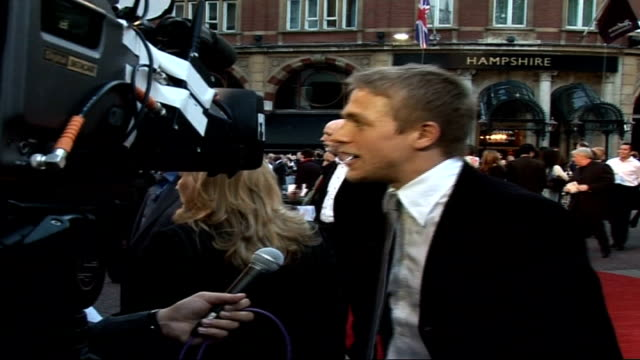 'Children of Men' film premiere Charlie Hunman along to press then hugging director Alfonso Cuaron / Charlie Hunman speaking to press SOT ' He's a...