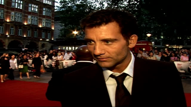 'children of men' film premiere; clive owen interview sot - a hugely talented cast / is a very charming, lovely guy, that was the only warm... - 俳優 マイケル・ケイン点の映像素材/bロール