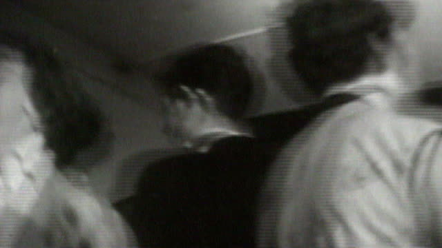 vidéos et rushes de children of the 60s and 70s will be worse off than parents; s20100601 england: london: b/w 1956 footage young people jiving at rock and roll club - rock