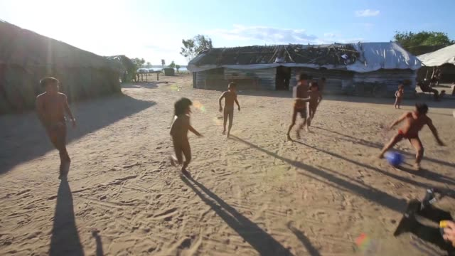 TS children of the Kamayura tribe play football shot on June 14th 2014